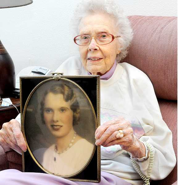 by: GARY ALLEN - Another time - Martha Pasko holds a picture of herself from her wedding day in 1933. She celebrated her 100th birthday this month.