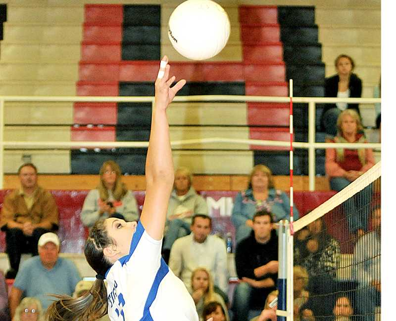 by: SETH GORDON - Newberg senior   middle blocker Emmie Schmidt hits a touch shot during the Tigers' 3-2 loss at McMinnville Sept. 26.