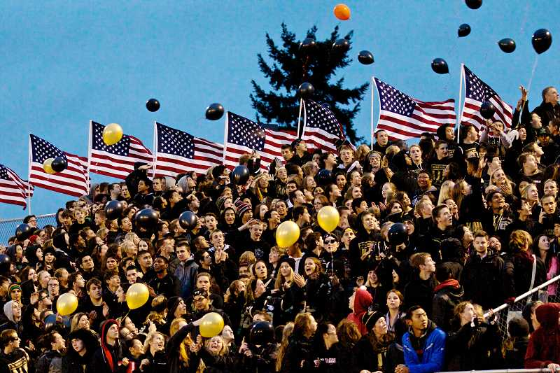 by: TIMES PHOTO: JAIME VALDEZ - The Southridge High School student body wore black T-shirts and released balloons in a tribute to 2008 Southridge graduate Andrew Keller. Proceeds from T-shirt and balloon sells will benefit creation of a Community Plaza on the east end of the campus stadium.