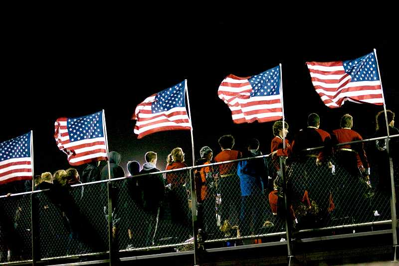 by: TIMES PHOTO: JAIME VALDEZ - Not even the blustery weather could dampen the spirits of the crowd as they gathered Friday night for the Memorial Game between Beaverton and Southridge High School.