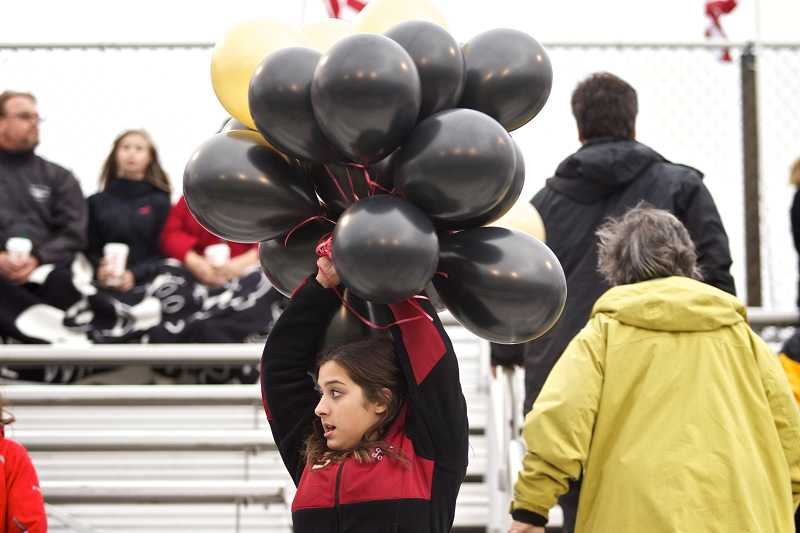 by: TIMES PHOTO: JAIME VALDEZ - Southridge High School cheerleader Taylor Chapman walks in the stands and sells balloons to help raise money for the school's Community Plaza Project.