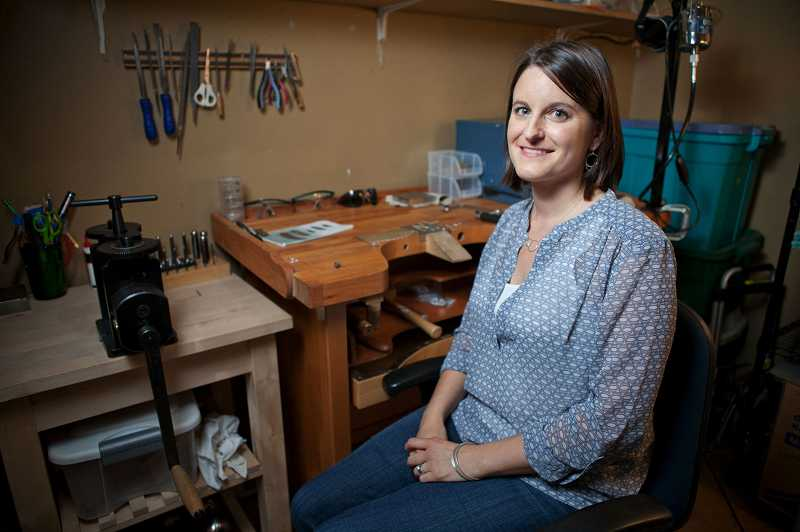 by: TIMES PHOTO: ADAM WICKHAM - Andrea Procida spends hours in her studio cutting shapes out of metal sheets, using a buffing machine, hammering the design and adding accents to earrings, necklaces and bracelets for her Andrea Wysocki Jewelry collections.