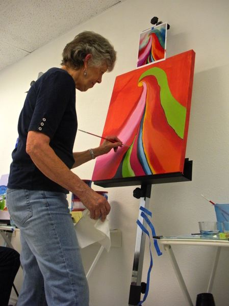 by: POST PHOTO: JIM HART - While studying the art of Georgia OKeefe, a Portland artist and author, Elizabeth Kirkhart of Gresham works on her interpretation (reproduction) of an OKeefe art piece. This photo was taken during an art class at the Lori Ryland gallery and studio in Sandy.