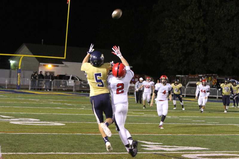 by: KORY MACGREGOR - Noah Kyllo (5) makes a catch Sept. 27 against Oregon City at Cougar Stadium. Without injured senior Sam Bodine, he and the Canby football team will face Lake Oswego on the road at 7 p.m. Oct. 4.