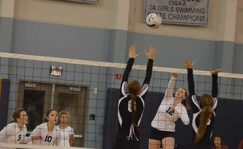 by: JEFF GOODMAN - Rebecca Wenz (12) follows through on a hit at home Sept. 26. She and the Wilsonville volleyball team defeated Sandy in four sets.