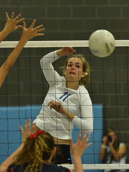 by: VERN UYETAKE - Lakeridge's Maddie Marshall finishes a kill during the Pacers' three-set victory over Lake Oswego last week.