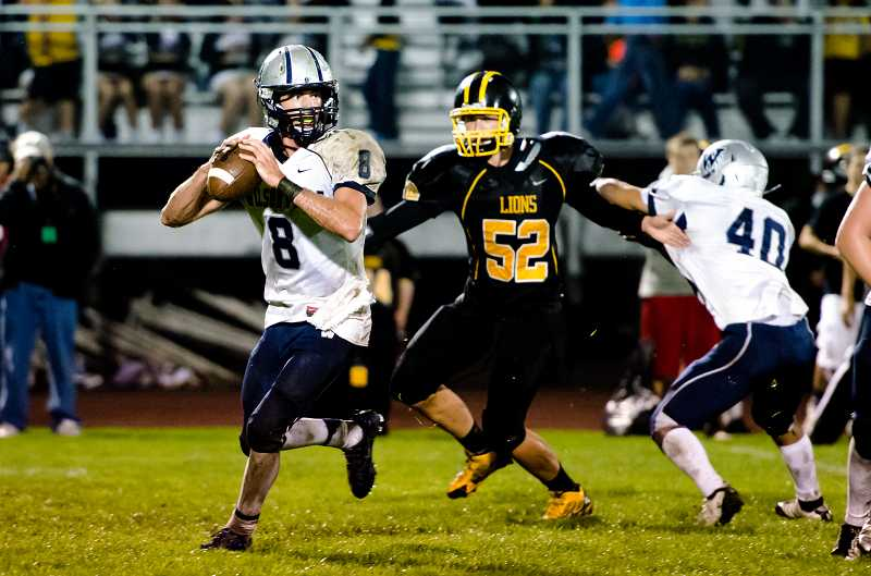 by: GREG ARTMAN - Tyler Carskadon (8) is one of several players in the rotation under center for the Wilsonvnille football team this season. Above, the senior evades pressure in the Wildcats' win at St. Helens.