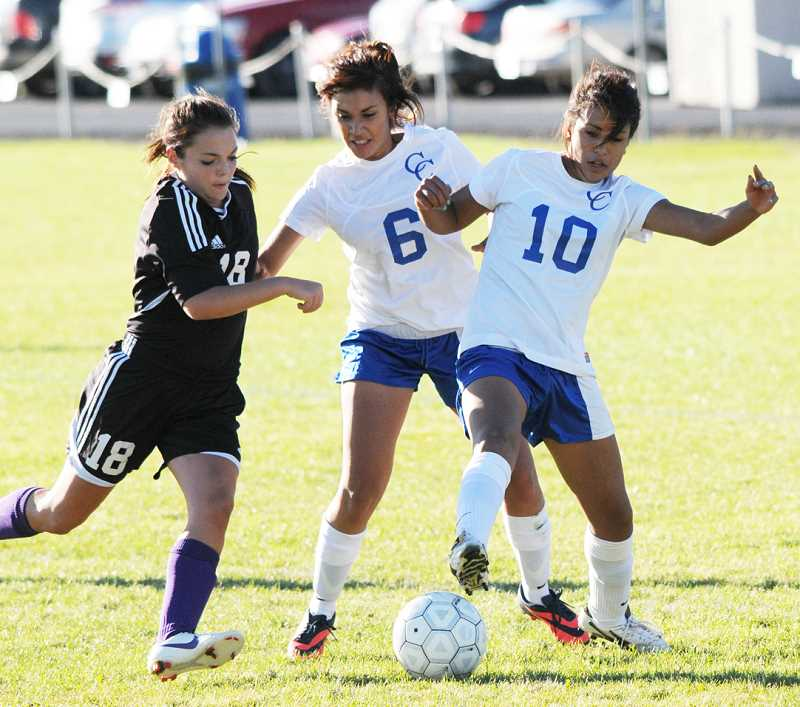 by: LON AUSTIN/CENTRAL OREGONIAN - Adrianna Villagomez (10) and Amy Gonzalez (6) play the ball during the first half of the Cowgirls match with the Ridgeview Ravens. The Ravens led 1-0 at halftime, but exploded for seven second-half goals in an 8-0 shutout of the Cowgirls.