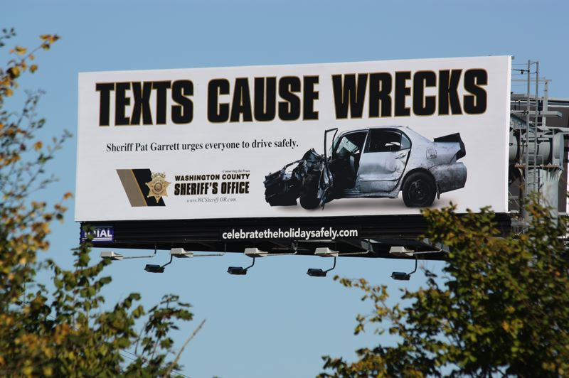 by: HILLSBORO TRIBUNE PHOTO: DOUG BURKHARDT - To help create awareness of the fact that texting while driving causes accidents, the Washington County Sheriffs Office sponsored this huge billboard near the intersection of Tualatin Valley Highway and 214th Avenue.