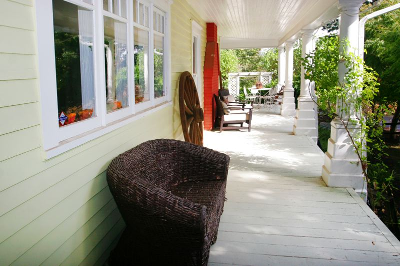 by: OUTLOOK PHOTO: JIM CLARK - The porch on Cedar Place extends around two sides of the house.