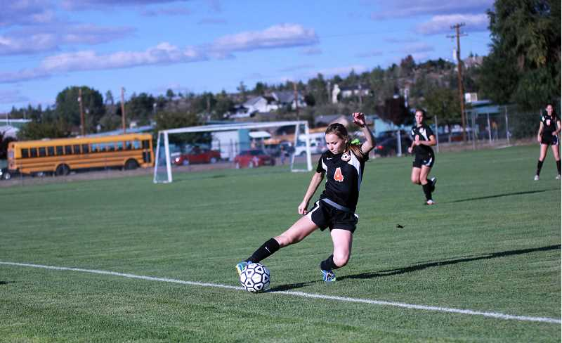 by: BILLY GATES - Audrey Bever keeping the ball in play.