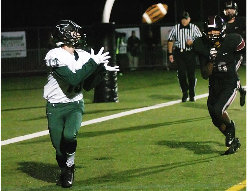 by: DAN BROOD - TD TOSS -- Tigard senior receiver Bruin Campbell (left) is about to catch a 6-yard touchdown pass from senior Jett Even.