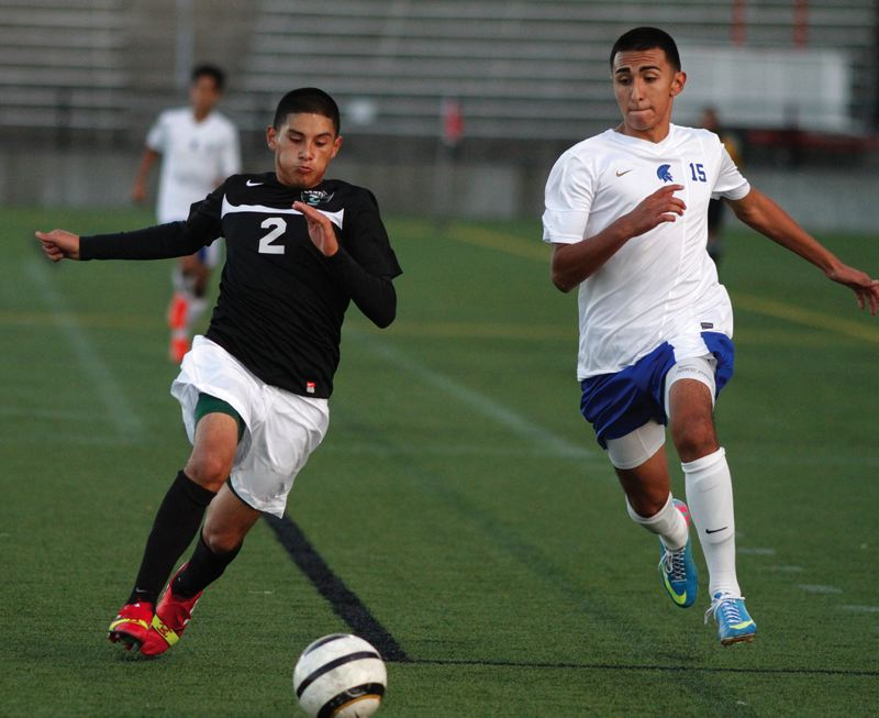 by: HILLSBORO TRIBUNE PHOTO: AMANDA MILES - Century's William Perez Rodriguez (2) and Hillsboro's Abran Serrano Garcia (15) converge on a loose ball during Tuesday's boys soccer match.