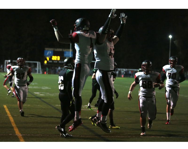 by: JON HOUSE - Dan Sherrell (left) and Brody Haehlen celebrate a touchdown in last Fridays 40-7 rout of West Linn.