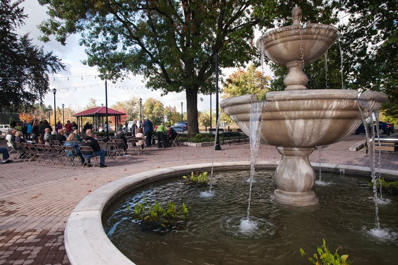 by: SPOKESMAN PHOTO: JOSH KULLA - Piazza Park at Villebois features a fountain, cobblestoned pavement and a host of benches for people to relax.