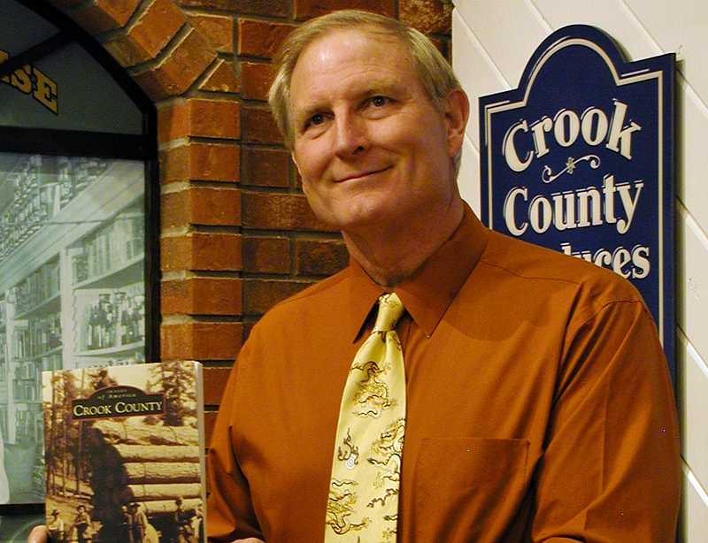 by: RON HALVORSON - Steve Lent displays his latest book, 'Crook County.'