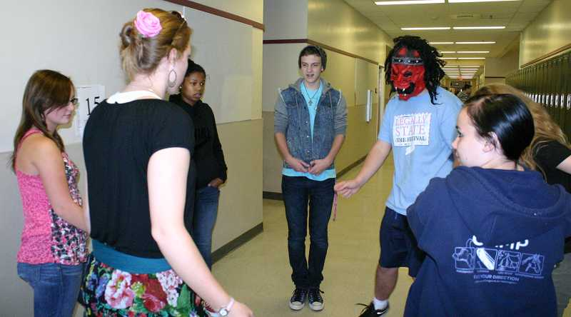 by: JASON CHANEY - Crook County High School sophomore drama student Mikanda Gallenero, (far left) brainstorms skit ideas with her team comprised of students from other schools throughout Oregon.