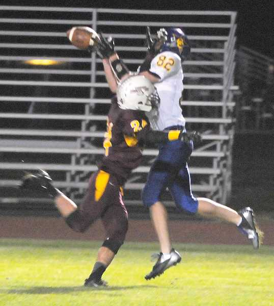 by: LON AUSTIN/CENTRAL OREGONIAN - Brant McCloughan catches a 26-yard touchdown pass from Crook County quarterback Mike Irwin during the Cowboys win over the Redmond Panthers on Friday. It was the first time the Cowboys have defeated the Panthers in 13 years.