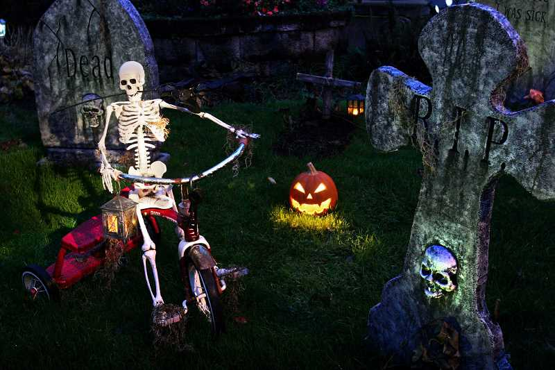 by: PAMPLIN MEDIA GROUP FILE PHOTO - A tricycle-riding skeleton is part of a 2012 Halloween display.