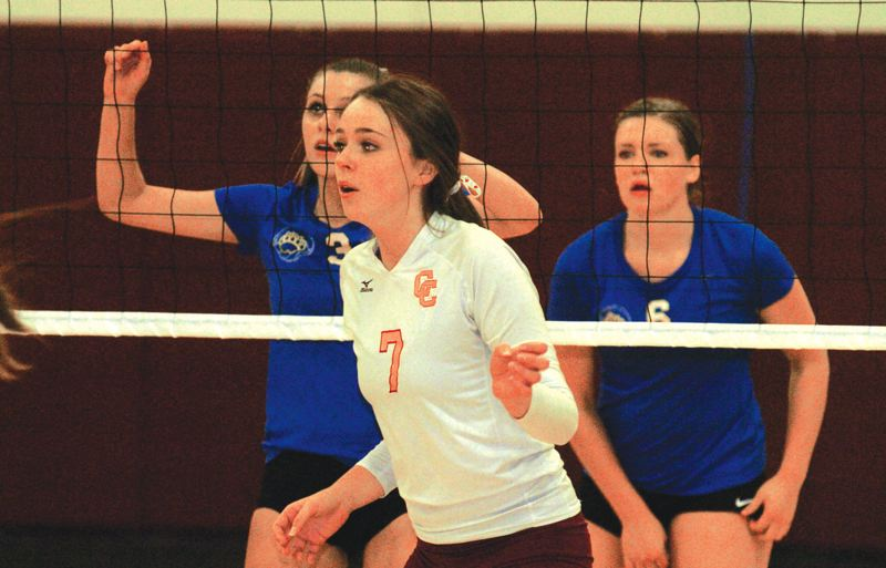 by: PAMPLIN MEDIA GROUP: DAVID BALL - Central Catholic setter Camille Foster directs traffic at the net.
