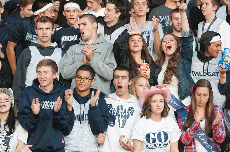 by: SPOKESMAN PHOTO: JOSH KULLA - Fans react to a play during the homecoming game against Milwaukie.