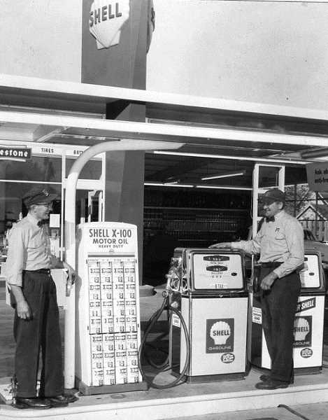 by: SUBMITTED - Eddie Stein (left) and Tony Kahut exchange smiles on the grand opening day of Kahut Shell, owned by Tony Kahut, on Dec. 1, 1961. Kahut Shell was one of a number of service stations that popped up around Woodburn during the 1960s.