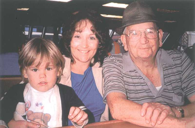 by: COURTESY OF BONNIE MCGREGOR - The author of the book, Howard Palmer, is pictured (far right) with his granddaughter, Bonnie McGregor, who published the book, and her son, Sean, in 1987. Palmer died in 1988.