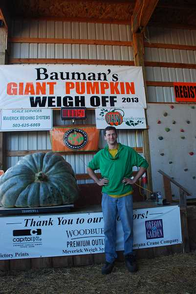 by: SUBMITTED - Scott Holub of Eugene boasted the largest squash ever recorded in Oregon, weighing in at 1,175 pounds at Bauman's Giant Pumpkin Weigh-off Saturday.