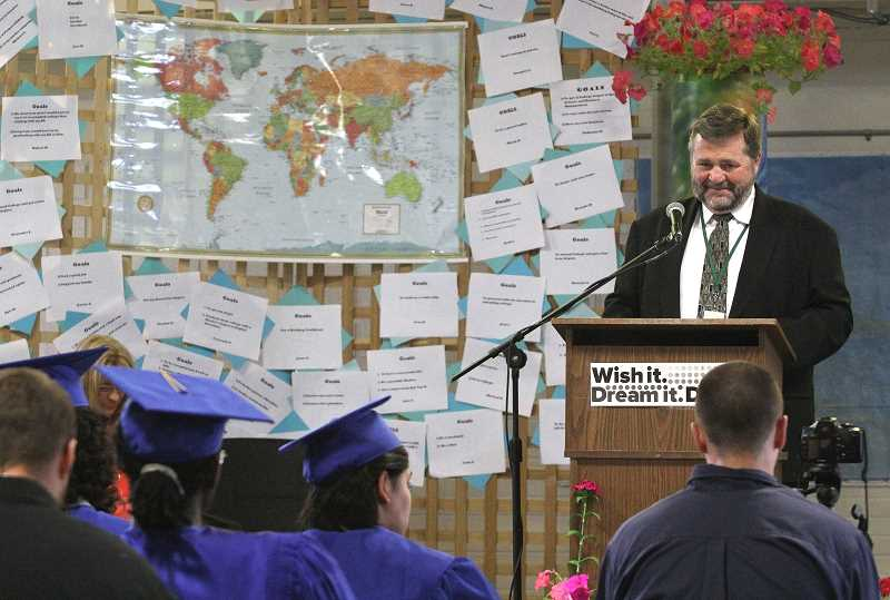 by: LINDSAY KEEFER - Lindsay Keefer | Woodburn Independent Scott Harris, principal of Lord High School at MacLaren Youth Correctional Facility, addresses graduates during a commencement ceremony in June. Harris is one of five MacLaren employees who will be laid off Nov. 1.