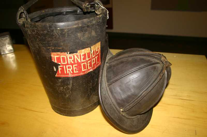 by: COURTESY PHOTO: WASHINGTON COUNTY MUSEUM - The ghosts of Cornelius firefighters past linger in this antique leather firemans helmet and bucket that turned up among Washington County Museum curios and will inspire Anne Rutherford to tell her original story about a heroic fireman who came back from the dead for one last rescue.