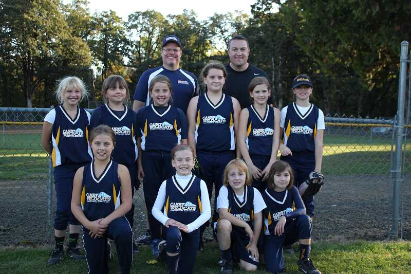 by: COURTESY PHOTO - The 10-and-under Canby Wildcats softball team took second place in a recent tournament. Front row (left to right): Alexis Sumner, Gabrielle Gray, Allison Mead and Kenna Kraft. Second row: Sophia Barr, Brooke Herren, Ellie Moore, Isabella Short, Sophie Wheeler and Jasmine Caulkins. Back row: coaches Jim Barr and Ty Kraft. Not pictured: Katie Anderson, Mallory Block, Katie Lambert, Clara Bates and coach Brett Block.
