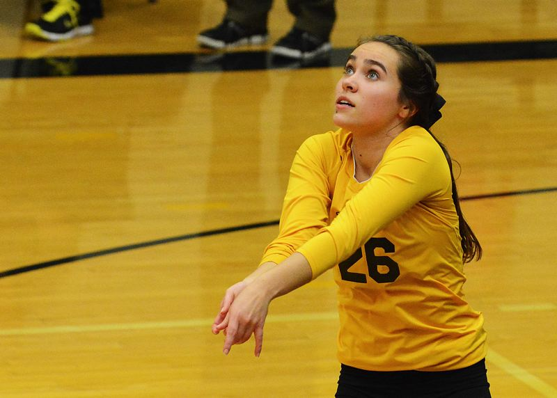 by: JOHN WILLIAM HOWARD - Senior libero Madison Kaplan gets under a serve in the second set against the Sandy Pioneers on Tuesday evening. Kaplan is part of a dominant senior class that makes up six of the 12 spots on this season's roster.