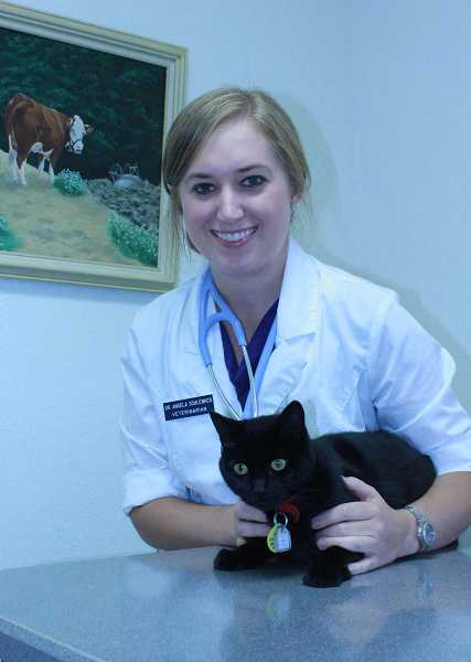 Vet Angela Schlenker with Mesa the cat.