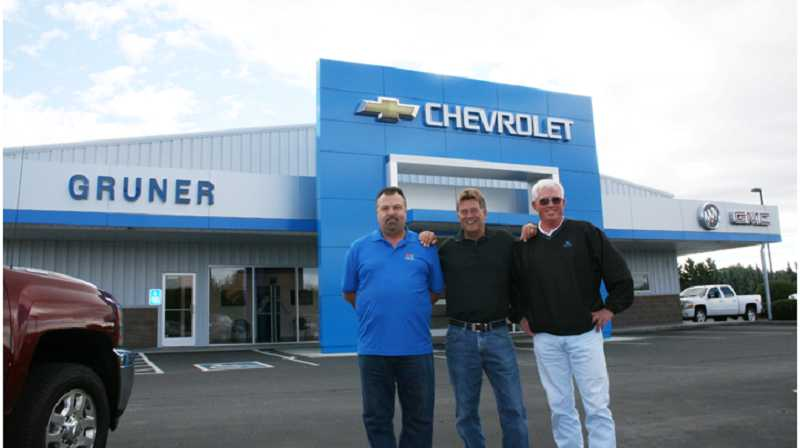 The partners at Gary Gruner Chevrolet, Mike Sacco, left, Gary Gruner and Denny Storey, in front of the new Chevrolet dealership facade that went up in September.