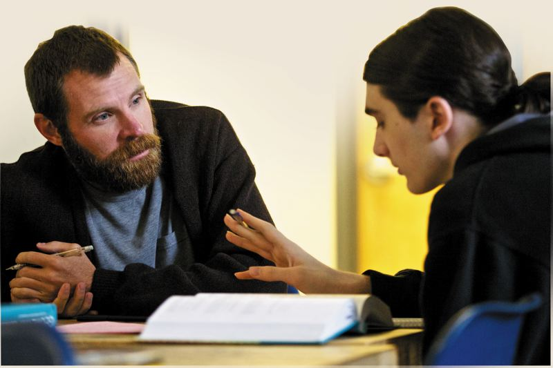 by: TRIBUNE PHOTO: JAIME VALDEZ - Reconnection Center teacher Caleb Jackson helps student Thomas OHara with a geometry problem. Outreach workers track down students who miss school for 10 days or more and invite them in to reconnect.