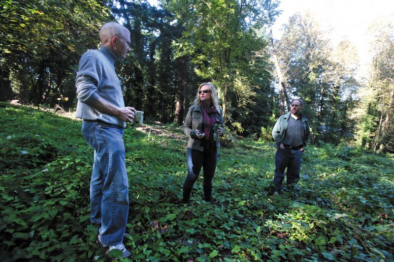 by: TRIBUNE PHOTO: JONATHAN HOUSE - Southwest Portland residents (from left) Jeremy Solomon, Terri Preeg Riggsby and Bill Kielhorn walked though the three-quarter acre city parcel they want preserved last week.