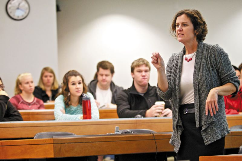 by: TRIBUNE PHOTO BY JAIME VALDEZ - Meg Garvin, executive director of the National Crime Victim Law Institute, here training Lewis & Clark law students, has taken her advocacy of victims rights the from criminal courts to military courts.