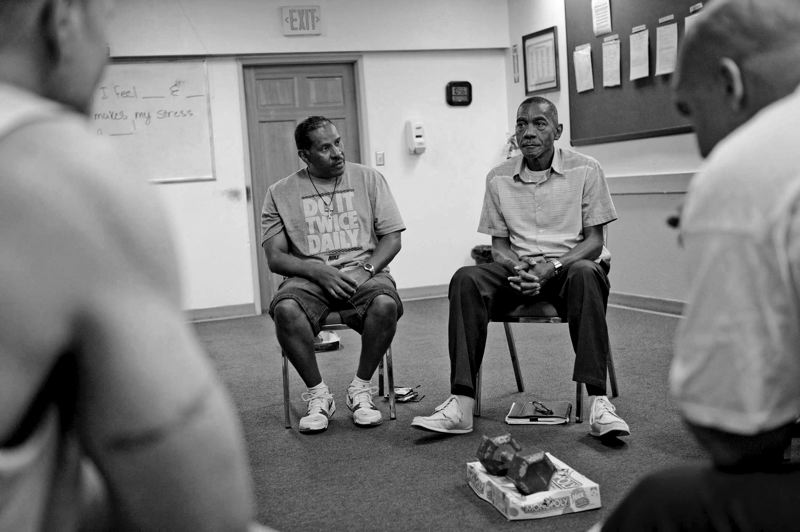 by: TRIBUNE FILE PHOTO: ADAM WICKHAM - Larry Jones (left) and Karl Colbert take part in a Volunteers of America group session in Northeast Portland as part of their rehabilitation treatment program. A letter writer says upheaval in the VOA program to affect its work.