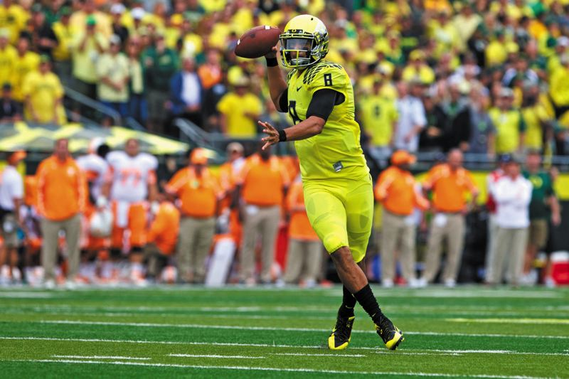 by: TRIBUNE PHOTO: JAIME VALDEZ - Oregon quarterback Marcus Mariota gives the Ducks national championship hopes, but UOs path gets tougher on Saturday with a Pac-12 road game at Washington.