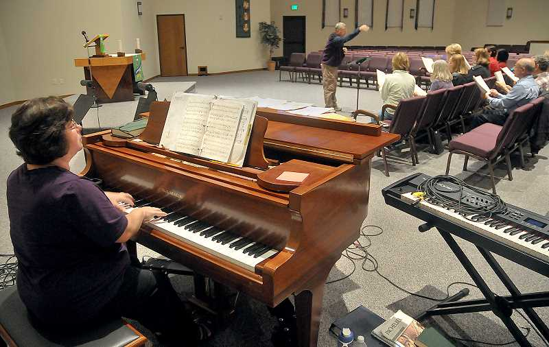 by: GARY ALLEN - A passion for music - Choir director Beth Randolph plays the piano during practice Sept. 26 at Joyful Servant Lutheran Church. Randolph is stepping down to pursue a career in music education.