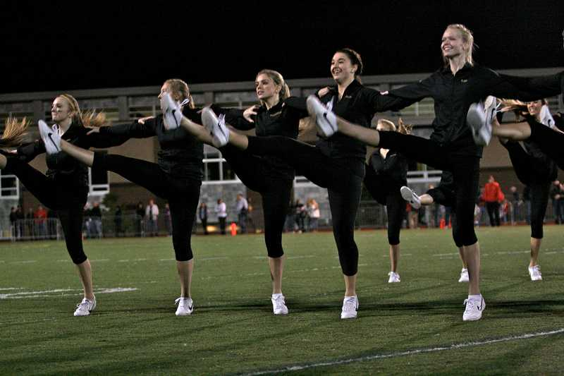 by: TIDINGS PHOTO: J. BRIAN MONIHAN - Members of the Debs dance team perform at the homecoming game.