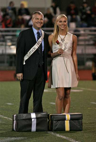 by: TIDINGS PHOTO: J. BRIAN MONIHAN - Senior Princess Maddie Groh is escorted by her father, Mike Groh. Her escort, senior Prince Danny Zakariya and a member of the varsity football team, was named homecoming king.