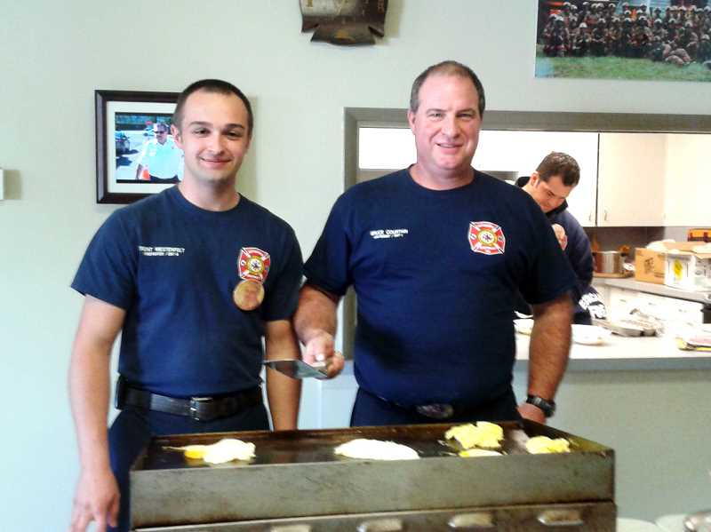 by: ISABEL GAUTSCHI - Trent Westenfelt (left) and Bruce Curtain pause between egg orders to smile for the camera.