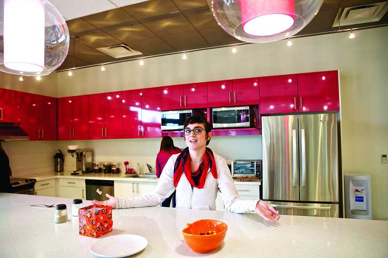 by: TIMES PHOTO: JAIME VALDEZ - Shawna Nordman, who has worked with Ruby Receptionists for five months, enjoys a lunch break in the posh kitchen at the businesses new Murray Scholls Town Center location.