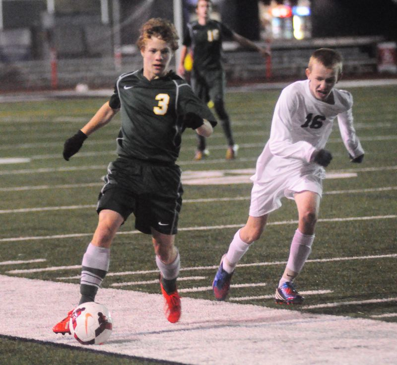 by: MATT SHERMAN - Lucas Evans looks to make a pass upfield in West Linn's win over Lake Oswego on Tuesday.