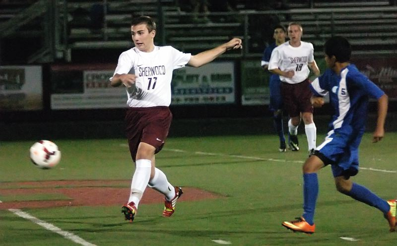 by: DAN BROOD - BOWMEN ON THE MOVE -- Sherwood senior Andrew Bukur (left) looks to get the ball up field during the Bowmen's 1-0 win over Hillsboro.