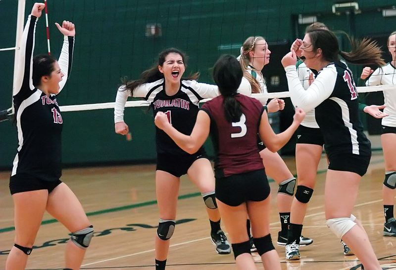 by: DAN BROOD - WOLVES GET GOING -- Tualatin's (from left) Haley Howarth, Sara Fanger, Beth Fanger and Emily Peters celebrate after scoring a point in Tuesday's Pacific Conference match at Tigard.