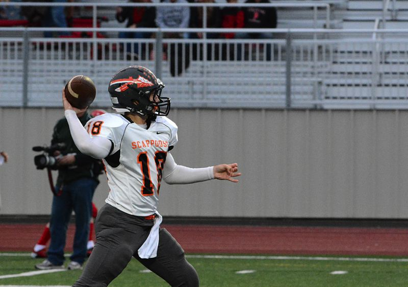 by: JOHN WILLIAM HOWARD - Senior quarterback Taylor Loss warms up before the Tribe's game in Independence. Coach Sean McNabb has been happy with the way Loss has dealt with adversity over the last few weeks.