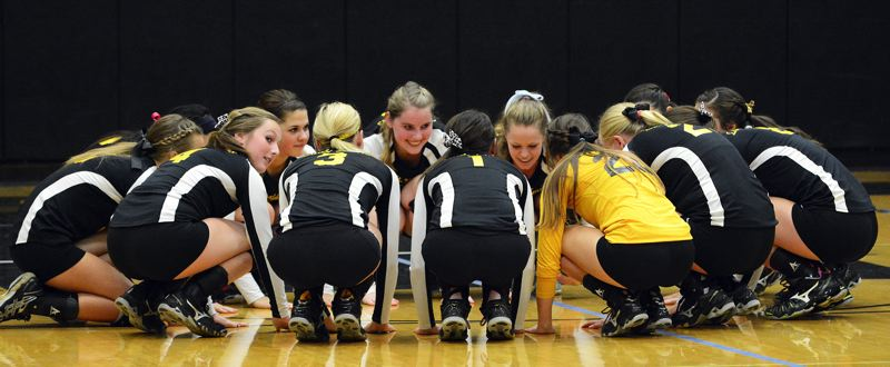 by: JOHN WILLIAM HOWARD - St. Helens volleyball players gather for a moment before the home match against Sandy on Oct. 8. The Lions swept Sandy in straight sets.