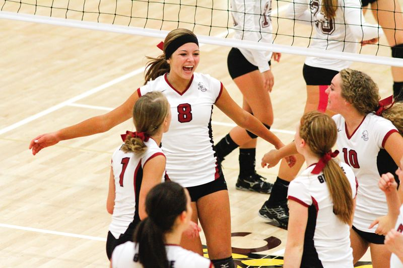 by: HILLSBORO TRIBUNE PHOTO: AMANDA MILES - Glencoe junior outside hitter Lauren Messmer celebrates a point with her teammates during the Crimson Tide's 21-25, 25-12, 25-10, 25-14 victory over Forest Grove on Tuesday.